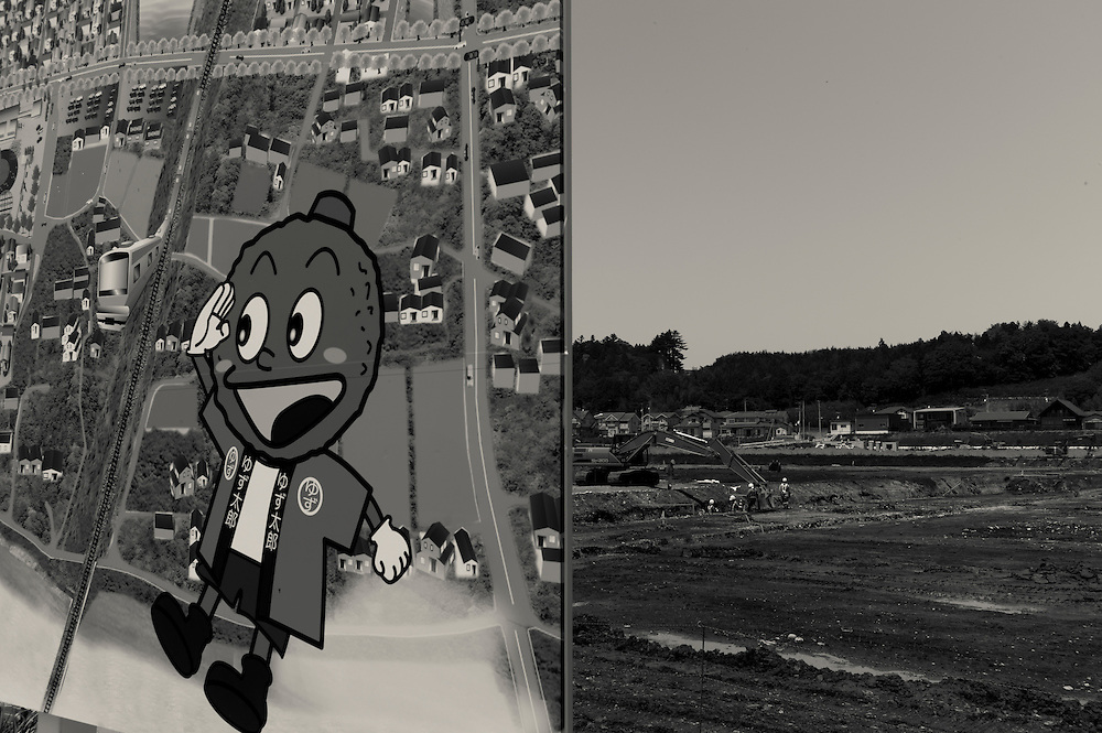 mascot  pictured on billboard advertizing the future site of Compact Village new construction  in Naraha.