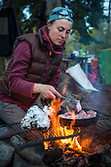 Yukon Territory, Canada, September 2014. Cooking dinner over the fire at the Big Salmon Village Campsite. During this Yukon River canoe trip we paddled part of the Klondike Gold Rush route of 1898. We camped on the banks of the Yukon River in authentic northern wilderness and explored the gold rush relics on the way. Photo by Frits Meyst / MeystPhoto.com