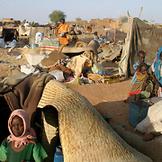 June 16, 2004- Recently displaced people from villages around the town of Nyala, Darfur set up a makeshift camp,with the few personal belongings they were able to carry, on a barren plain on the outskirts of Nyala after fleeing their villages when they were attacked by the Janjaweed. They currently have no adequate shelter and many are sleeping in the open. Photo by Evelyn Hockstein/CARE