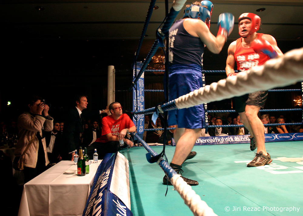UK ENGLAND LONDON 2DEC04 - Boxers John Partridge (Blue) and Justin Floyd trade punches during the 4th Real Fight Club City Broker Christmas Bash at the London Mariott Hotel, Mayfair. The high-adrenaline contact sport of White Collar Boxing originated in New York 17 years ago and attracts mostly young males from the financial, legal and medical professions.....jre/Photo by Jiri Rezac ....© Jiri Rezac 2004....Contact: +44 (0) 7050 110 417..Mobile:  +44 (0) 7801 337 683..Office:  +44 (0) 20 8968 9635....Email:   jiri@jirirezac.com..Web:    www.jirirezac.com....© All images Jiri Rezac 2004 - All rights reserved.