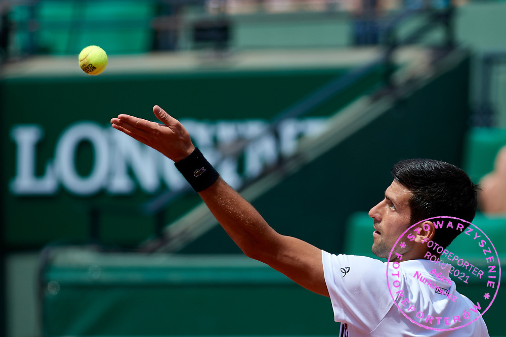Paris, France - 2017 May 31: Novak Djokovic from Serbia serves while his men's single match second round during tennis Grand Slam tournament The French Open 2017 (also called Roland Garros) at Stade Roland Garros on May 31, 2017 in Paris, France.<br /> <br /> Mandatory credit:<br /> Photo by &copy; Adam Nurkiewicz<br /> <br /> Adam Nurkiewicz declares that he has no rights to the image of people at the photographs of his authorship.<br /> <br /> Picture also available in RAW (NEF) or TIFF format on special request.<br /> <br /> Any editorial, commercial or promotional use requires written permission from the author of image.