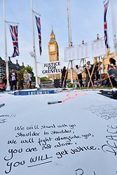 © Licensed to London News Pictures. 19/06/2017. London, UK.  People gather for a vigil in Parliament Square to remember those who died in the Grenfell Tower fire in North Kensington of 14 June.  Mourners and wellwishers were given the opportunity to speak and to write messages on a community banner.  Photo credit : Stephen Chung/LNP