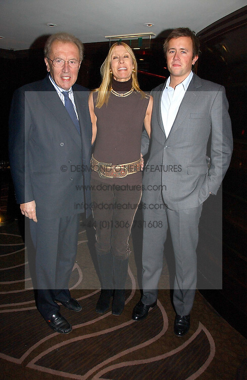 SIR DAVID & LADY CARINA FROST with their son MILES FROST at a party following the premier of Blood Diamonds hosted by Amnesty at The Dorchester, Park Lane, London on 23rd January 2007.<br /><br />NON EXCLUSIVE - WORLD RIGHTS