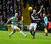 4th April 2018, Celtic Park, Glasgow, Scotland; Scottish Premier League football, Celtic versus Dundee; Kevin Holt of Dundee clears from Scott Brown of Celtic