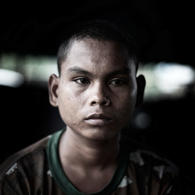 A Burmese Army child soldier's Soe Min Oo, from Irrawady Division and 17 years old, pose for a portrait in Kachin's jail of Woi Chyai for prisioners of war in Laiza village close to the China border, Myanmar on July 15, 2012. Was captured 3 months ago near to A Law Bum.