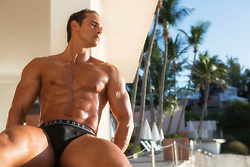 muscular man in bikini briefs