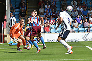 Jordan Clarke  clears ball from goal area during the Sky Bet League 1 match between Scunthorpe United and Millwall at Glanford Park, Scunthorpe, England on 22 August 2015. Photo by Ian Lyall.