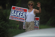 Sylvia Baker, candidate for tax assessor of Lafayette County, holds a sign as she campaigns outside the polls at the Oxford Conference Center in Oxford, Miss. on Tuesday, Aug. 23, 2011. Baker defeated Lisa Spragins and since she has no Republican opposition, will be the county's new tax assessor.