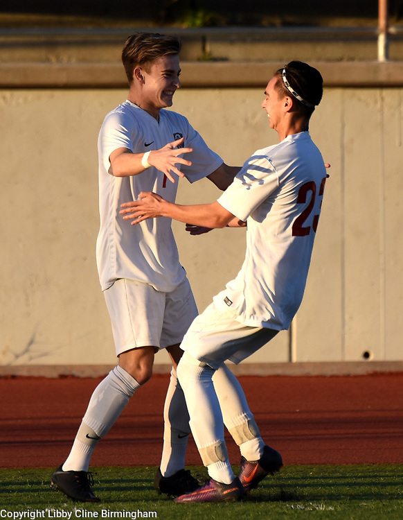 Glendora's Sebastian Occhiato, left, celebrates with his teammate Andrew Nunez, right, after scoring the first goal in the first half of a first round CIF soccer prep soccer match against Colony at Citrus College in Glendora, Calif., on Friday, Feb. 16, 2018. (Photo by Libby Cline Birmingham)