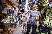 01 APRIL 2013 - BANGKOK, THAILAND:   Amy Hupe and Molly Evans walk through a Bangkok market on their way to dinner.  PHOTO BY JACK KURTZ