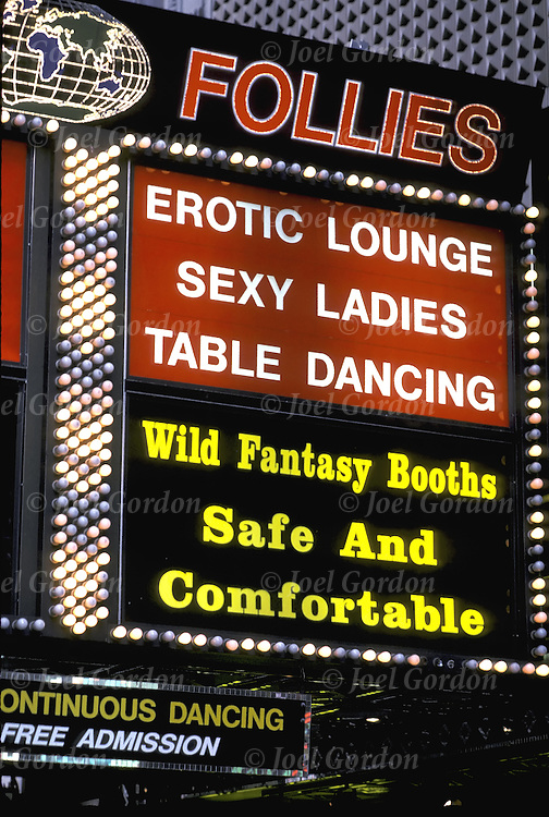 "Sex for Sale - Neon sign "" Follies - Erotic Lounge - Table Dancing - Sexy Ladies"" - sex club /strip club - xxx movies - ....The video/VCR/DVD and internet revolution drove ""porno"" movie houses out of business as individuals became able to view  x-rated videos, DVDs, and Web sites in the privacy of their own homes."