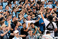 Sydney FC supporters at the Hyundai A-League Round 8 soccer match between Western Sydney Wanderers FC and Sydney FC at ANZ Stadium in NSW, Australia