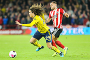 Arsenal midfielder Matteo Guendouzi (29) and Sheffield United forward Billy Sharp (10) compete for the ball during the Premier League match between Sheffield United and Arsenal at Bramall Lane, Sheffield, England on 21 October 2019.