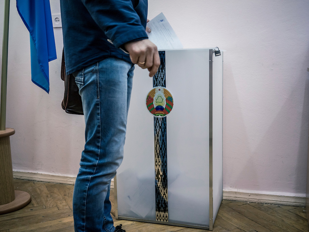 A man casts his ballot at polling station where early voting is taking place on Wednesday, October 7, 2015 in Minsk, Belarus. A presidential election is planned for Sunday with current president Alexander Lukashenko expected to secure a fifth term, though as in the past, the election is not expected to be declared free by monitors or the opposition.