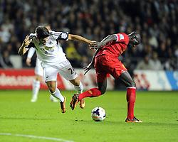 Swansea City's Alejandro Pozuelo is fouled by Liverpool's Mamadou Sakho - Photo mandatory by-line: Joe Meredith/JMP - Tel: Mobile: 07966 386802 16/09/2013 - SPORT - FOOTBALL -  Liberty Stadium - Swansea - Swansea City V Liverpool - Barclays Premier League