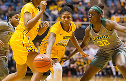 Jan 30, 2016; Morgantown, WV, USA; West Virginia Mountaineers guard Bria Holmes (23) drives between defenders during the first quarter against the Baylor Bears at WVU Coliseum. Mandatory Credit: Ben Queen-USA TODAY Sports