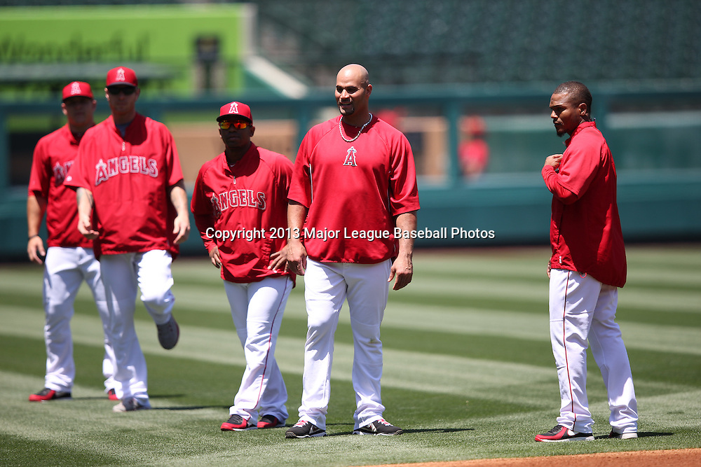ANAHEIM, CA - JUNE 15:  Albert Pujols #5 of the Los Angeles Angels of Anaheim (2nd from right) watches batting practice other members of the Los Angeles Angels of Anaheim before the game against the New York Yankees on Saturday, June 15, 2013 at Angel Stadium in Anaheim, California. The Angels won the game 6-2. (Photo by Paul Spinelli/MLB Photos via Getty Images) *** Local Caption *** Albert Pujols