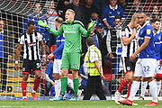 Oldham Athletic goalkeeper Daniel Iversen (1) reacts during the EFL Sky Bet League 2 match between Grimsby Town FC and Oldham Athletic at Blundell Park, Grimsby, United Kingdom on 15 September 2018.