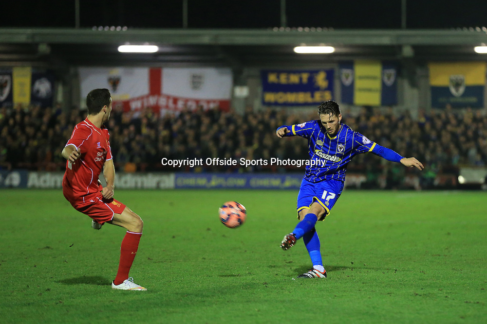5 January 2015 - The FA Cup 3rd Round - AFC Wimbledon v Liverpool - Callum Kennedy of AFC Wimbledon crosses the ball - Photo: Marc Atkins / Offside.