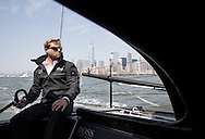 New York. USA. 26th May 2016. Hudson River.Pictures of British yachtsman Alex Thomson onboard his Hugo Boss IMOCA 60 race prior to the start of the New York - Vendee solo transatlantic yacht race<br />
