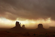 The Mittens and Merick Butte in a dust storm. Monument Valley, Arizona.