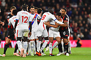 Callum Wilson (13) of AFC Bournemouth and Cheikhou Kouyate (8) of Crystal Palace pulls James Tomkins (5) of Crystal Palace away from a heated exchange with during the Premier League match between Bournemouth and Crystal Palace at the Vitality Stadium, Bournemouth, England on 1 October 2018.