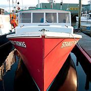 Red lobster boat in Gloucester Harbor, Massachusetts