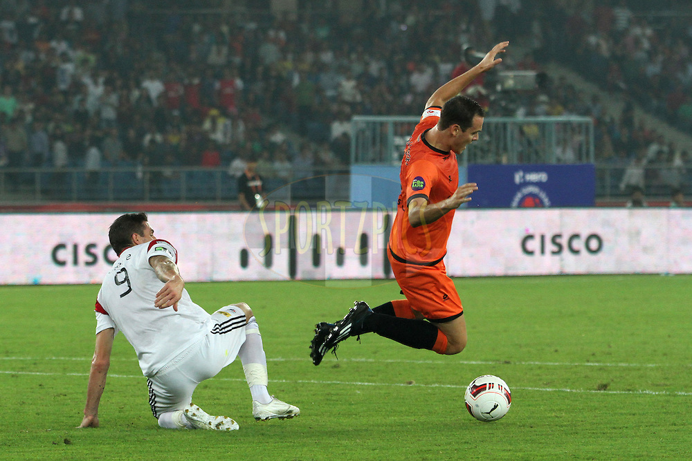 James Keene of NorthEast United FC and Wim Raymaekers of Delhi Dynamos FC fall down during match 16 of the Hero Indian Super League between The Delhi Dynamos FC and NorthEast United FC held at the Jawaharlal Nehru Stadium, Delhi, India on the 29th October 2014.<br /> <br /> Photo by:  Deepak Malik/ ISL/ SPORTZPICS