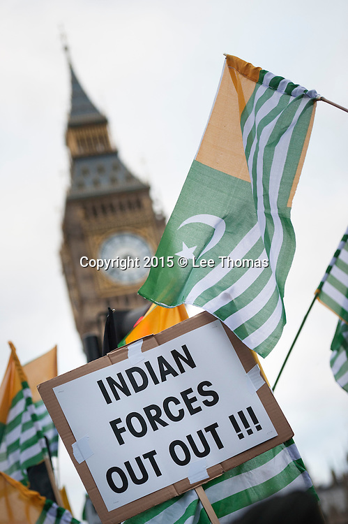 """Parliament Square, London, UK. 12th November, 2015. Around a 1000 protesters from all over the UK demonstrate at the edge of Parliament Square against India Prime Minister Narendra Modi's visit to Britain. Organised by campaign group Awaaz Network the demonstrators are made up of a number of religious and campaign groups, all of whom are calling upon the public not to """"buy the stage-managed, internationally orchestrated hype about Modi"""". Sikhs in the UK have backed concerns of Muslim groups, holding Modi responsible for the """"massacre of at least 2,000 Muslims"""" during the Gujarat riots. They have also called on the Indian Prime Minister to release Sikh political prisoners and demanded justice for the Sikh Genocide of November 1984, which resulted in nearly 2,800 deaths. Nepalese activists also joined the 'Modi Not Welcome' protest together with members of the South Asia Solidarity Group, Sikh Federation UK, Southall Black Sisters, Dalit Solidarity Network UK, Indian Muslim Federation, Indian Workers Association, Muslim Parliament, and Voice of Dalit International. Pictured:   // Lee Thomas, Flat 47a Park East Building, Bow Quarter, London, E3 2UT. Tel. 07784142973. Email: leepthomas@gmail.com. www.leept.co.uk (0000635435)"""