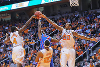 Jan 7, 2012; Knoxville, TN, USA; Tennessee Volunteers guard Wes Washpun (4) and forward Kenny Hall (20) block a shot from Florida Gators guard Erving Walker (11) during the game at Thompson Boling Arena. Tennessee won 67 to 56.