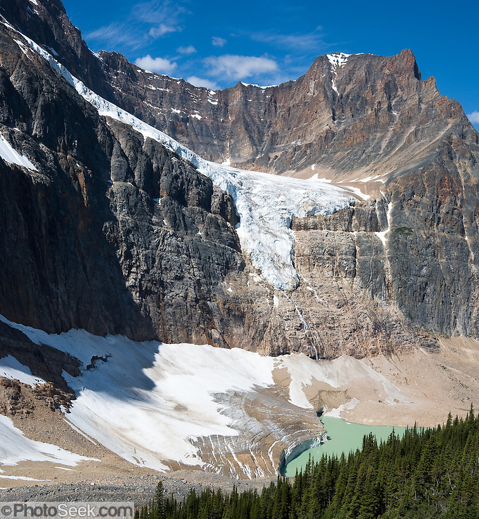 On Mount Edith Cavell, Angel Glacier lies in a cirque above Cavell Glacier and Cavell Pond, in Jasper National Park, Alberta, Canada. Jasper is part of the Canadian Rocky Mountain Parks World Heritage Site declared by UNESCO in 1984. Stitched from 2 overlapping images.