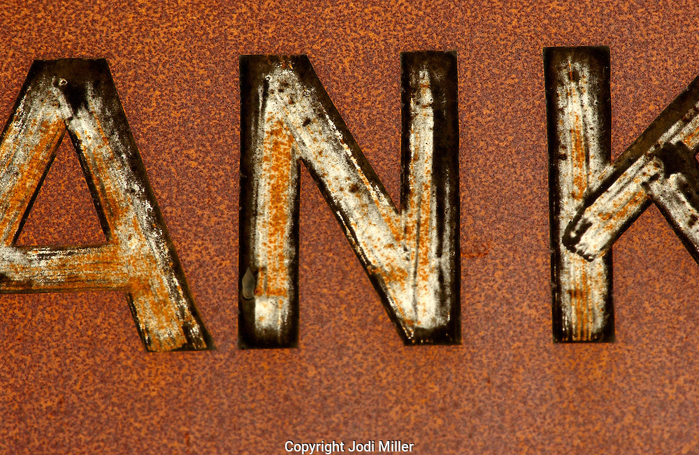 Detail of letters on a rusty sign.