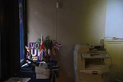 "© London News Pictures. ""Looking for Nigel"". A body of work by photographer Mary Turner, studying UKIP leader Nigel Farage and his followers throughout the 2015 election campaign. PICTURE SHOWS - Flags and an ancient photocopier in UKIP's office in Rochester, Kent, on March 5th 2015. Mark Reckless campaigned in the constituency after defecting from the Conservative party but ultimately failed to win his seat. . Photo credit: Mary Turner/LNP **PLEASE CALL TO ARRANGE FEE** **More images available on request**"