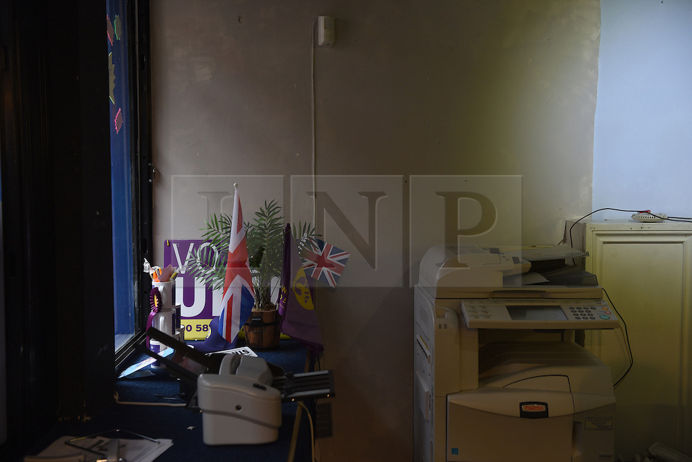 """© London News Pictures. """"Looking for Nigel"""". A body of work by photographer Mary Turner, studying UKIP leader Nigel Farage and his followers throughout the 2015 election campaign. PICTURE SHOWS - Flags and an ancient photocopier in UKIP's office in Rochester, Kent, on March 5th 2015. Mark Reckless campaigned in the constituency after defecting from the Conservative party but ultimately failed to win his seat. . Photo credit: Mary Turner/LNP **PLEASE CALL TO ARRANGE FEE** **More images available on request**"""