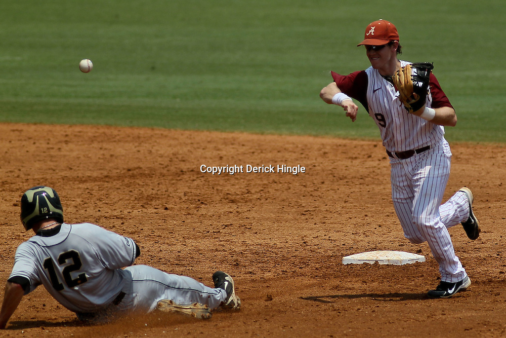 June 05, 2011; Tallahassee, FL, USA; Alabama Crimson Tide short stop Jared Reaves (9) forces out UCF Knights right fielder Erik Hempe (12) during the third inning of the Tallahassee regional of the 2011 NCAA baseball tournament at Dick Howser Stadium. Alabama defeated UCF 12-5. Mandatory Credit: Derick E. Hingle