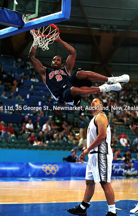 Vince Carter dunks a basket during the mens basketball match between the USA and New Zealand, 23 September 2000, Sydney Olympics.  PHOTO: PHOTOSPORT