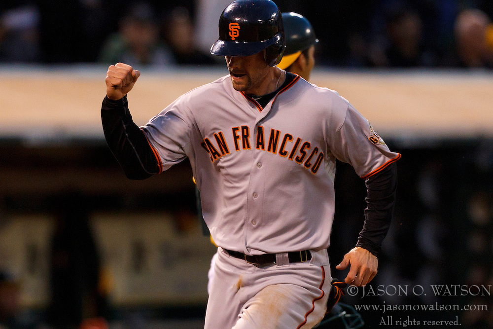 June 18, 2011; Oakland, CA, USA;  San Francisco Giants catcher Chris Stewart (37) scores a run against the Oakland Athletics during the fifth inning at the O.co Coliseum.