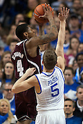 UK guard Jarrod Polson, right, contests a shot by Mississippi State guard Trivante Bloodman in the first half. The University of Kentucky Men's Basketball team hosted Mississippi State , Wednesday, Feb. 27, 2013 at Rupp Arena in Lexington .
