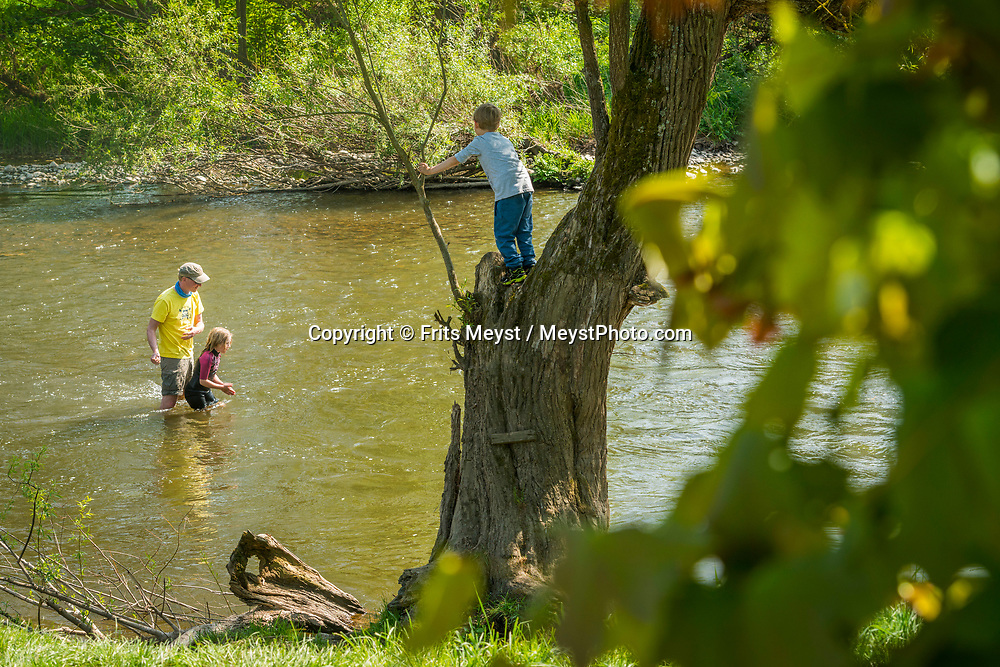 Monzingen, Nahetal, Germany, May 2018.  Families play in and around the Nahe river at Camping Nahemuhle. The Nahe region is named after the river that traverses the valleys of the forested Hunsrück Hills as it flows towards the Rhine. A landscape of vineyards, orchards and meadows interspersed with cliffs and striking geological formations. Photo by Frits Meyst / MeystPhoto.com