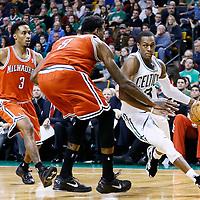 21 December 2012: Boston Celtics point guard Rajon Rondo (9) drives past Milwaukee Bucks point guard Brandon Jennings (3) and Milwaukee Bucks center Larry Sanders (8) during the Milwaukee Bucks 99-94 overtime victory over the Boston Celtics at the TD Garden, Boston, Massachusetts, USA.