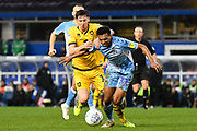 Milton Keynes Dons midfielder Conor McGrandles (18) battles for possession  with Coventry City defender Sam McCallum (31) during the EFL Sky Bet League 1 match between Coventry City and Milton Keynes Dons at the Trillion Trophy Stadium, Birmingham, England on 11 January 2020.