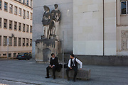Students gather beneath figures in Praca da Porta Ferrea, at Coimbra University, Portugal.