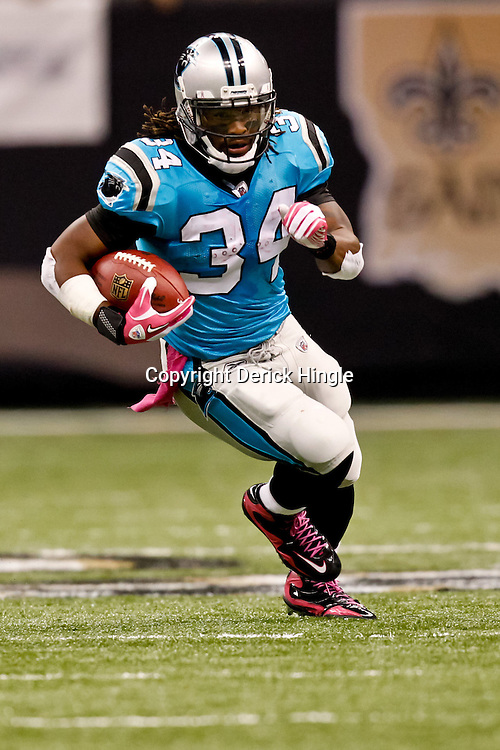 October 3, 2010; New Orleans, LA, USA; Carolina Panthers running back DeAngelo Williams (34) runs for a touchdown against the New Orleans Saints during a game at the Louisiana Superdome. The Saints defeated the Panthers 16-14. Mandatory Credit: Derick E. Hingle