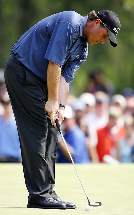 Phil Mickelson of the US putts on the fifth hole during the third day of the US Open Golf Championship at Winged Foot Golf Club in Mamaroneck, New York Saturday, 17 June 2006. .