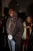 Sol Campbell, Giorgio Armani, ' A retrospective' sponsored by Mercedes, Royal Academy, 14 October 2003. © Copyright Photograph by Dafydd Jones 66 Stockwell Park Rd. London SW9 0DA Tel 020 7733 0108 www.dafjones.com