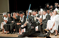 Keynote speaker Brian Stuart makes quite an entrance on stage during Prospect Mountain High School's commencement exercises Friday evening.  (Karen Bobotas/for the Laconia Daily Sun)