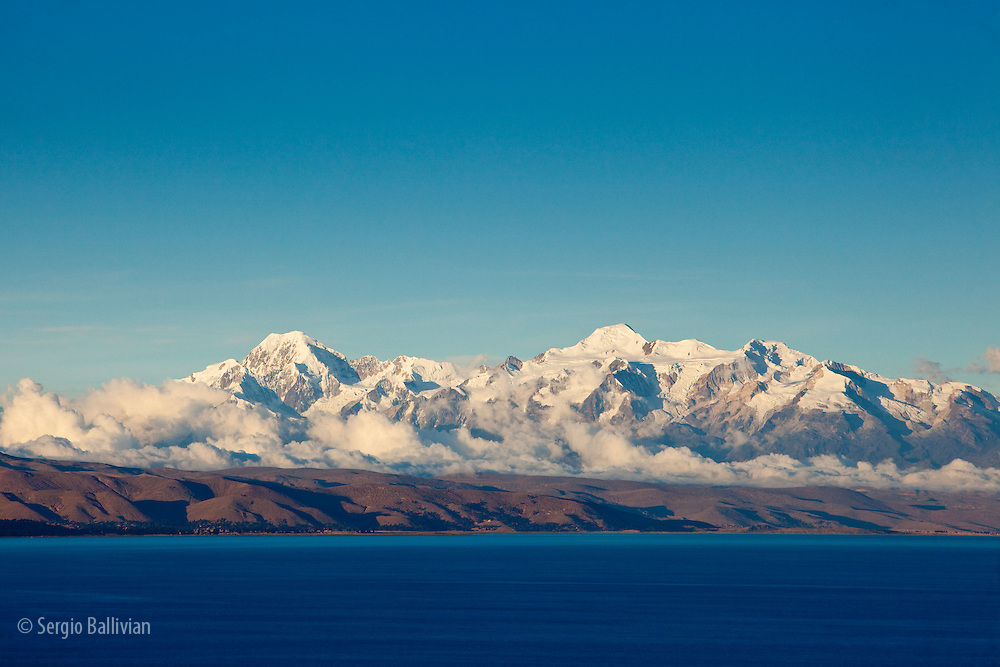Mt. Illampu and Mt. Ancohuma in the Cordillera Real mountain range as seen from Lake Titicaca, Bolivia