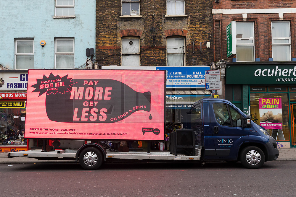 © Licensed to London News Pictures. 23/11/2018. London, UK.  A 'pay more get less' People's Vote campaign van drives past their stunt pop-up shop in Peckham High Street on Black Friday to show that the government's Brexit deal is a bad deal and the shop is stocked with household products, such as 'chlorinated' chicken to illustrate the bad deal. Photo credit: Vickie Flores/LNP
