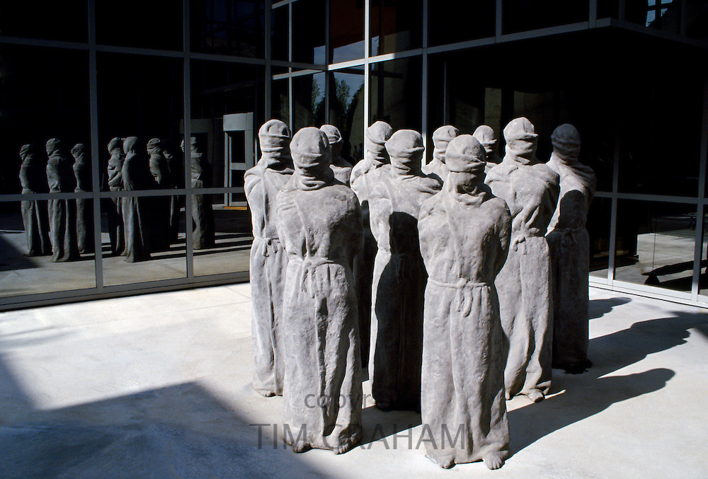 """The """"Petrified"""" a group of shrouded, life-size figures by Swiss artist Carl Bucher denouncing the violation of human rights at the entrance of the Museum of the International Red Cross in Geneva."""