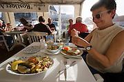 """Nicole Schmidt having green herring at restaurant """"Rostiger Anker""""."""